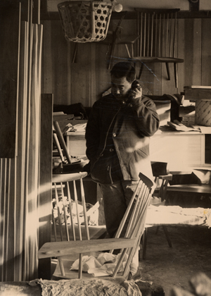 George Nakashima on the phone in his workshop