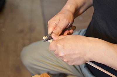 Eiji Hagiwara trimming the chopsticks by hand at his studio in Japan.