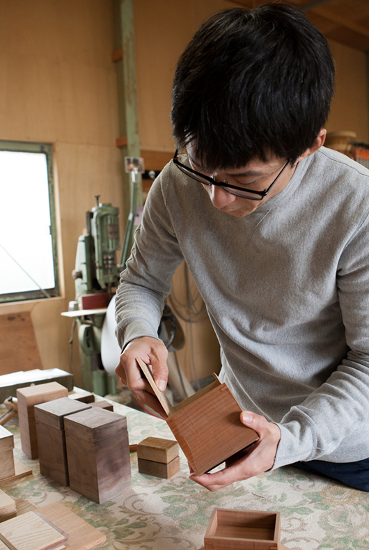 Kenichi sands some of the objects in his studio in Ono, Hyogo.