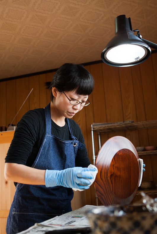 Finishing the lacquer dish with a clear lacquer to create a nice shine across the surface.