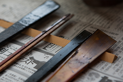 A selection of brushes and tools used to apply the lacquer to the vessels.