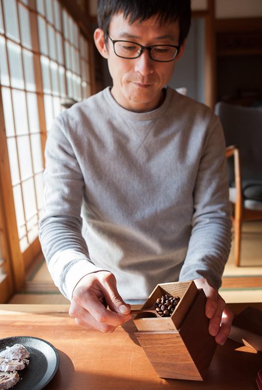 Kenichi uses his walnut tea box to put coffee inside.