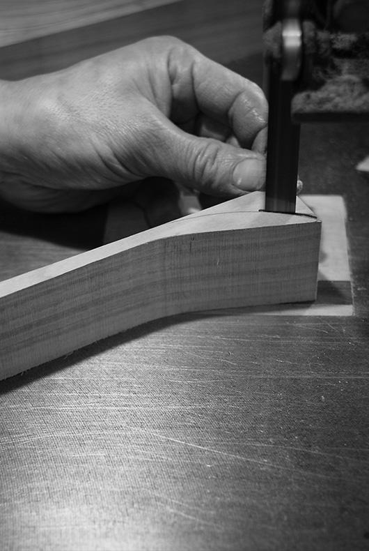 Here Hiroyuki Sugawara cuts the desired shape for a spoon.