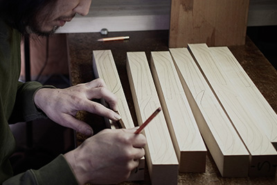 Next he draws out the template for the spoons, making sure that he makes the most out of the wood.