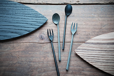 A selection of lacquer cutlery and tableware, like the small black spoon and shizuka plate.