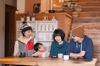 Satoko and Yuichiro Suzuki with their two children at their beautiful home in the village of Kawakami-mura in Yoshino, Nara Prefecture.