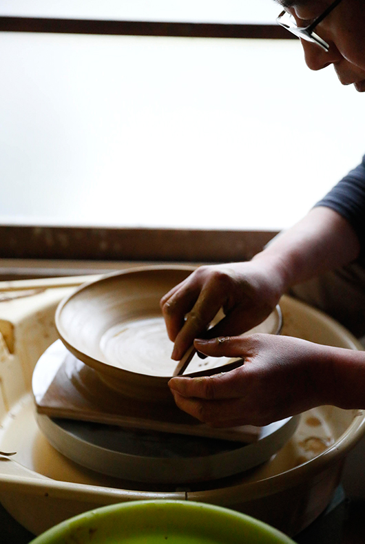 Makoto Asebi kneads the clay at his studio in Kamakura, Japan.