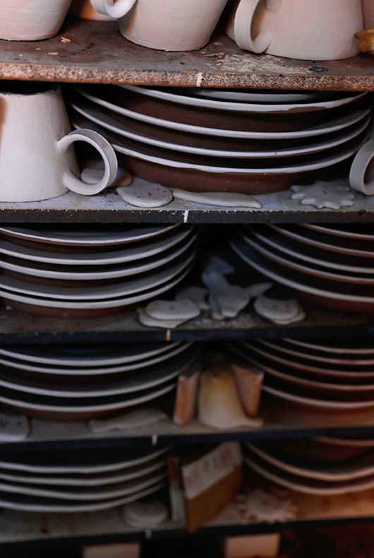 Cups and plates in the kiln at Makoto Asebi's studio.