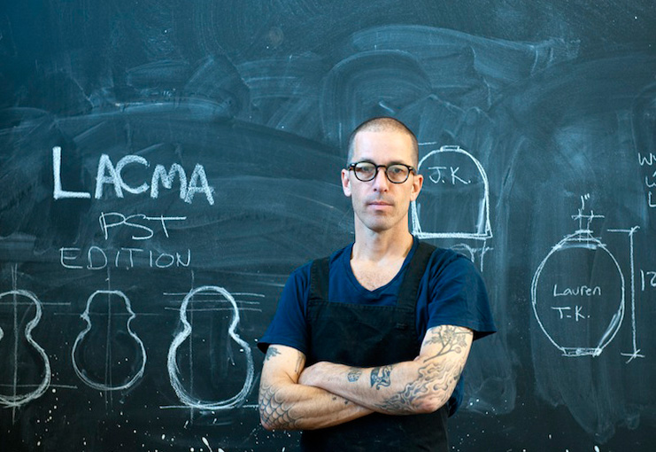 Adam Silverman in front of his chalkboard.
