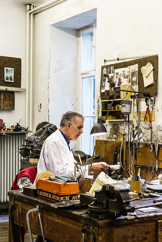 A man at work at his workshop in Vienna, Austria.