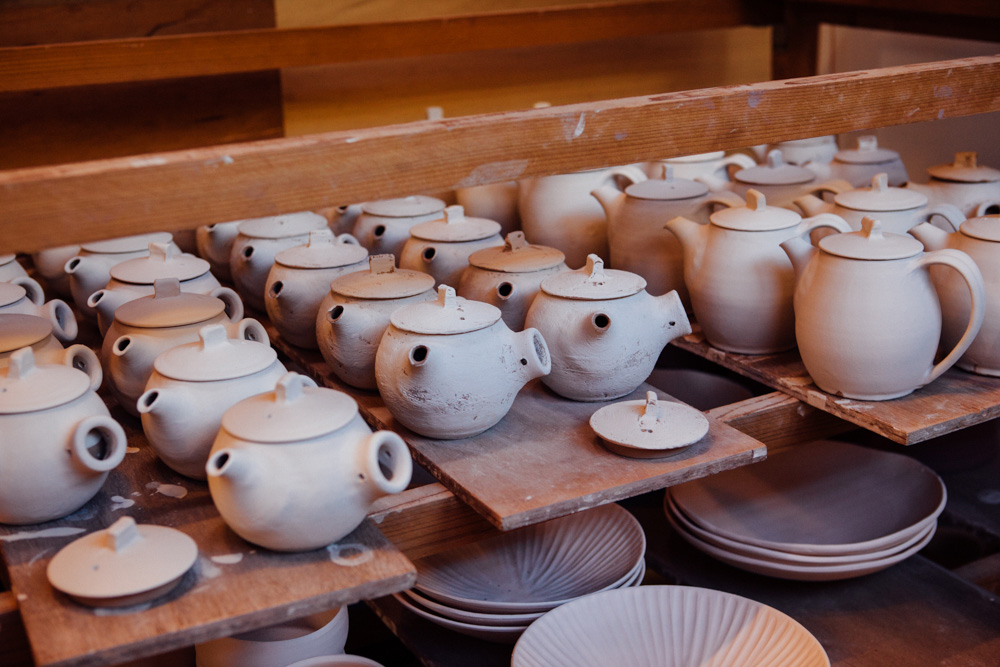 These teapots have been dipped in glaze and are ready for firing, a beautiful matte finish.