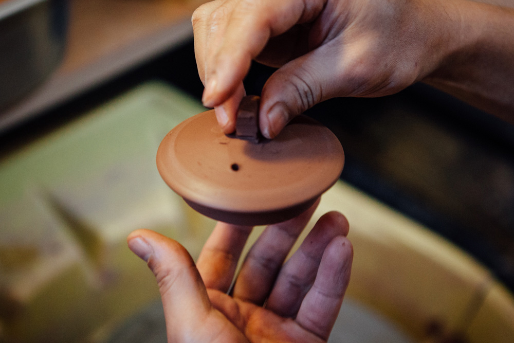 A small piece of clay is attached to the lid, making it easy to hold and lift up.
