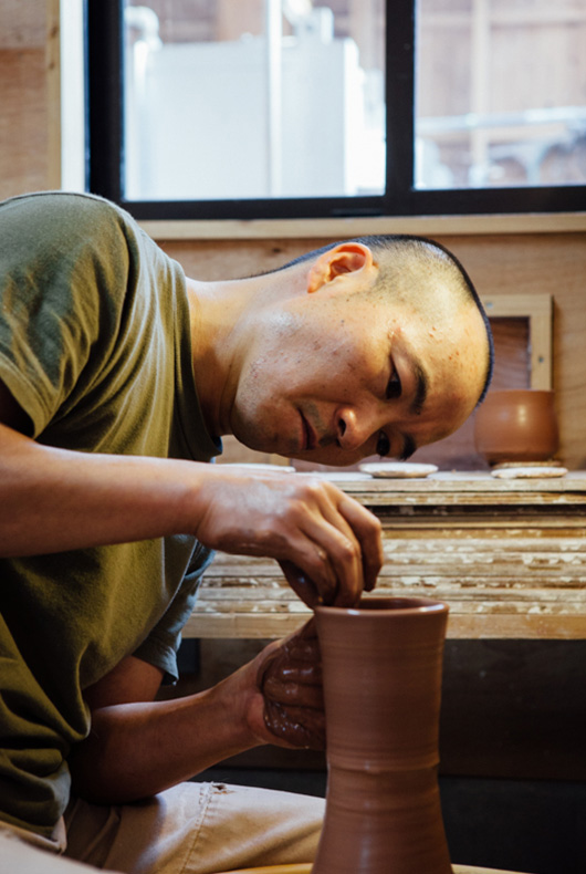 Katsufumi Baba on the pottery wheel, here he shapes and forms his pieces from clay.