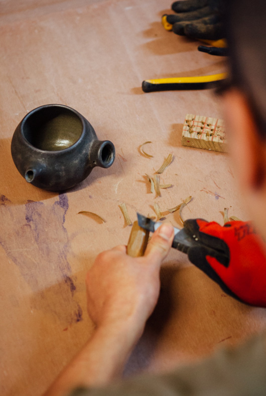 Back in the studio he shapes the end of the handle to fit nicely in to the teapot.