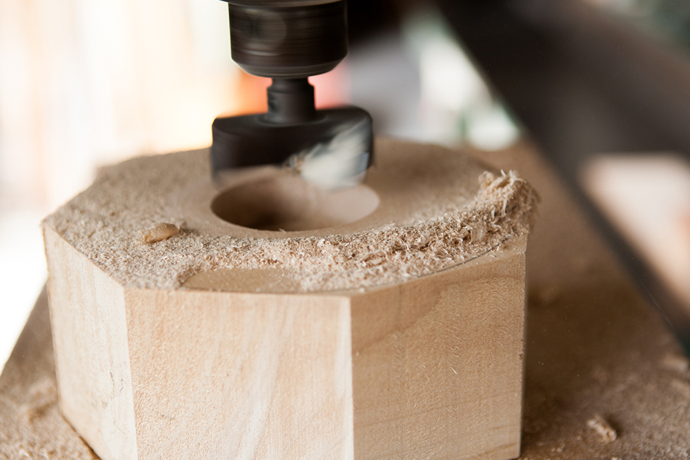 Kenichi turns a hole in the back of another blank, this will be used to attach to the lathe.