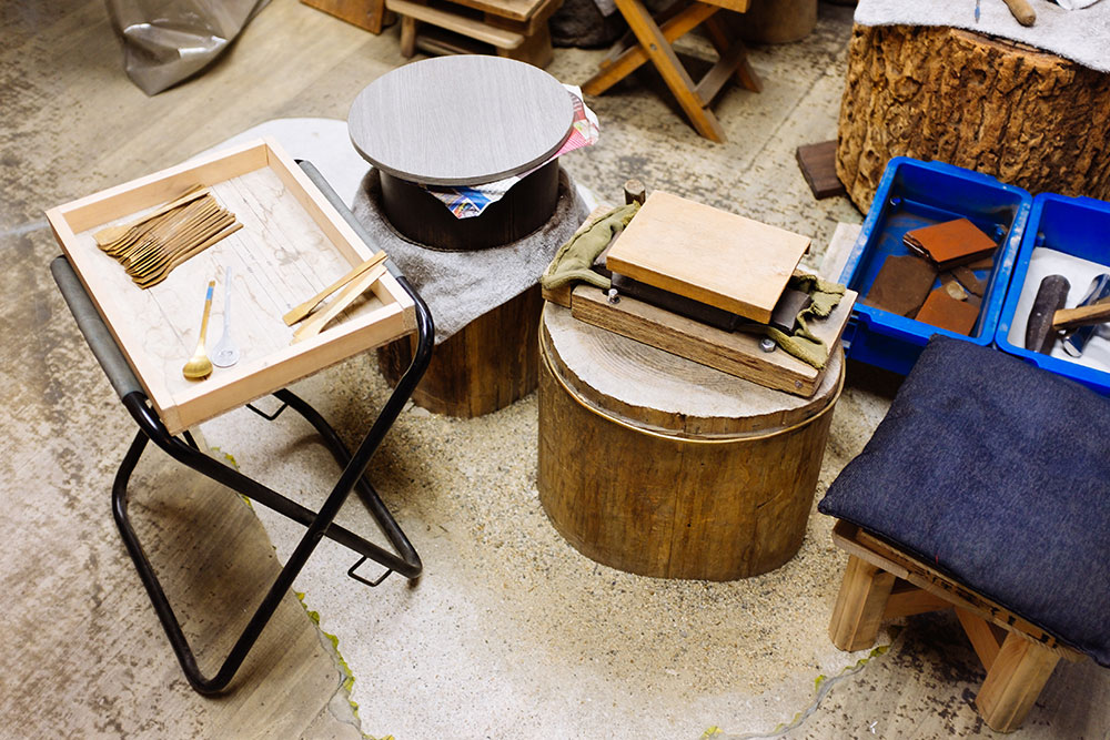 Rieko Fujimoto's Studio, including stool and wooden tables.