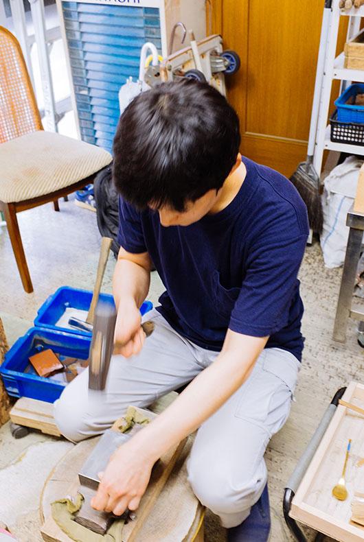 Rieko Fujimoto working inside her studio.