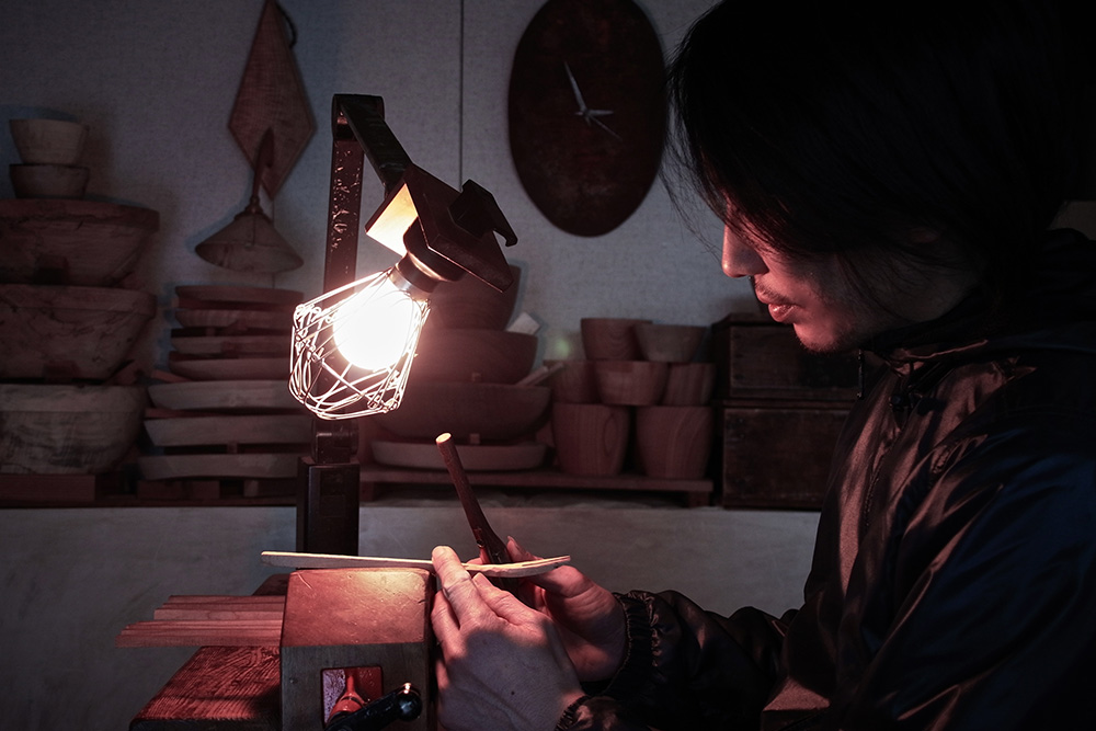 Hiroyuki Sugawara in his workshop, shaping a fork in to the desired shape.