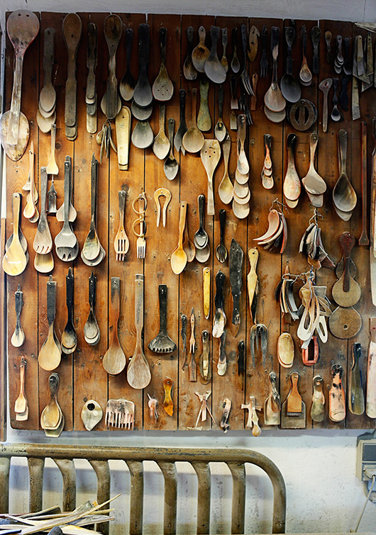 A wall of historic spoons and accessories, some are used as templates when finishing the new products.