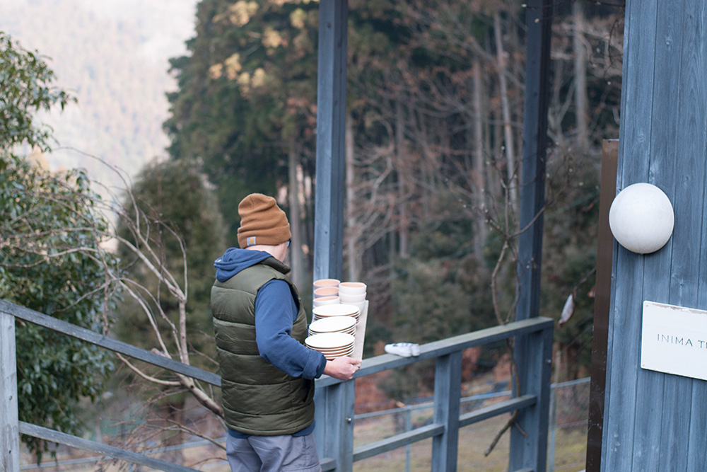 Yuichiro carrying the pots down to the kiln, this is where they will be fired.