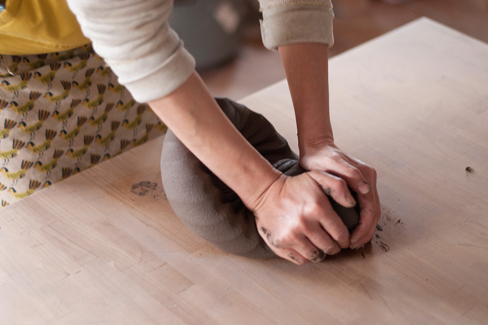 Satoko uses a spiral kneading technique to work out any air bubbles or impurities stuck in the clay.
