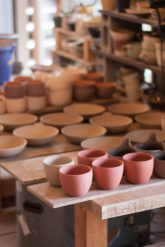 Pots that are ready to go in the kiln, each has its own style and character.