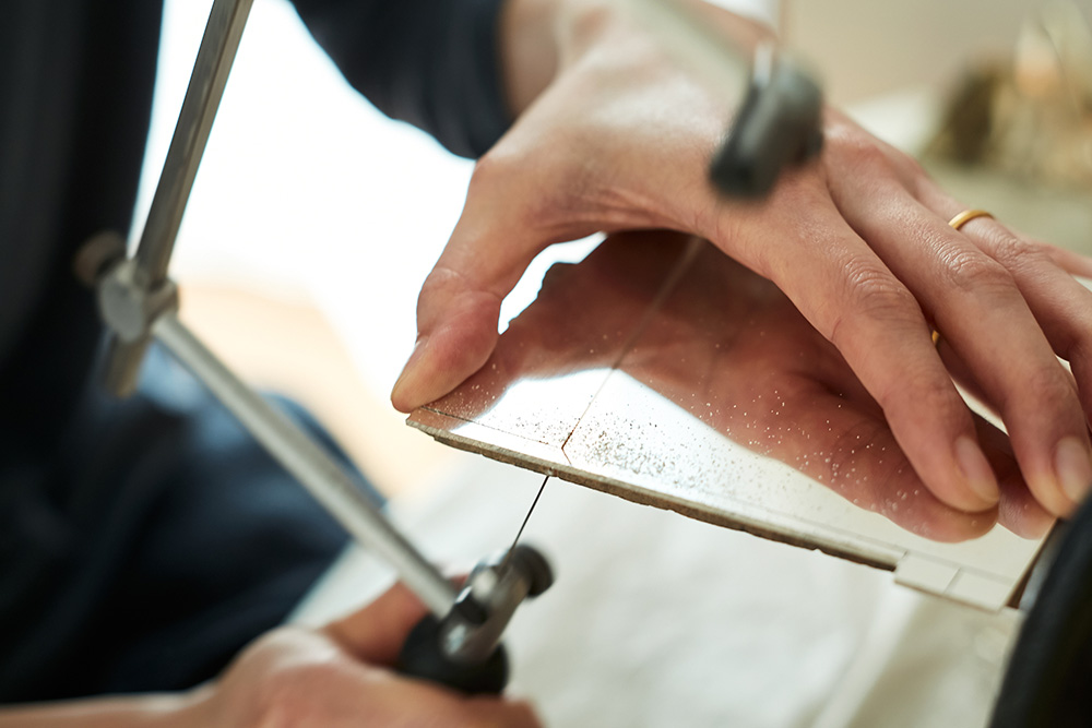 Upclose detail of sawing the metal.