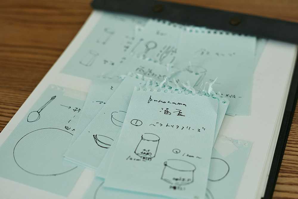Sketching ideas inside of her studio.