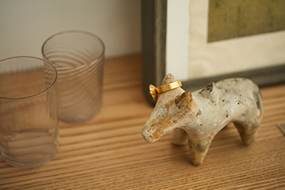 A ring and a small sculpture in the studio of metalworker Naho Kamada.
