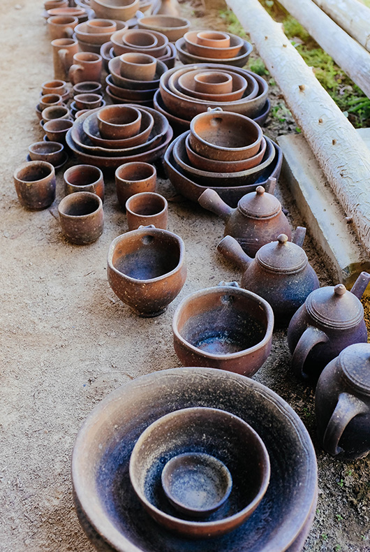Keiji Tanaka's wood-fired pottery sitting near his kiln.