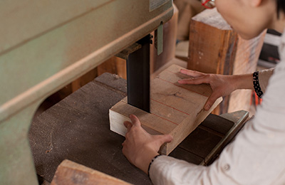 Cutting a selection of wooden blanks that will be used to craft her beautiful wooden objects.