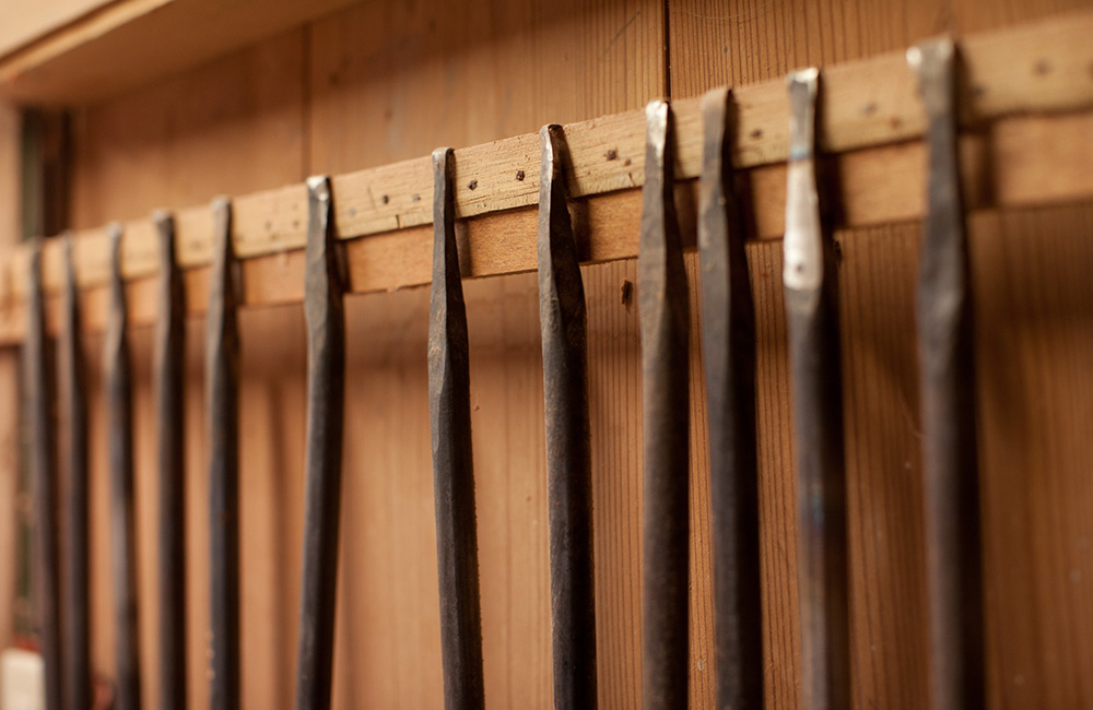 Maiko's custom chisels that are heated and crafted by hand, manipulating the tips for different purposes.