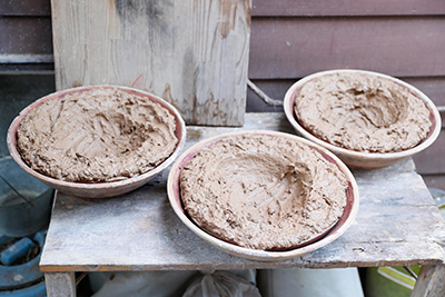 Leaving the clay to dry outside, this will later be kneaded and re-used.