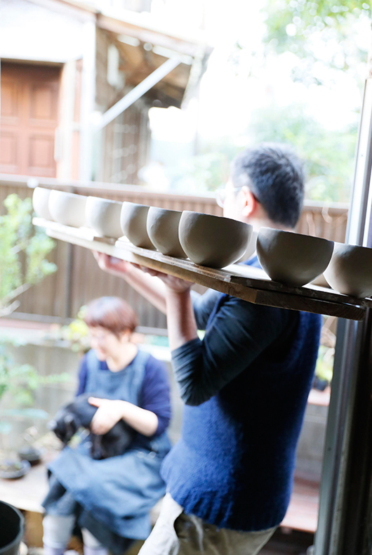 Makoto Asebi and his wife at his home/studio in Japan.