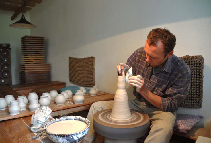 Matthias Kaiser making in his studio on a wooden kick wheel, influenced from his training in Japan.