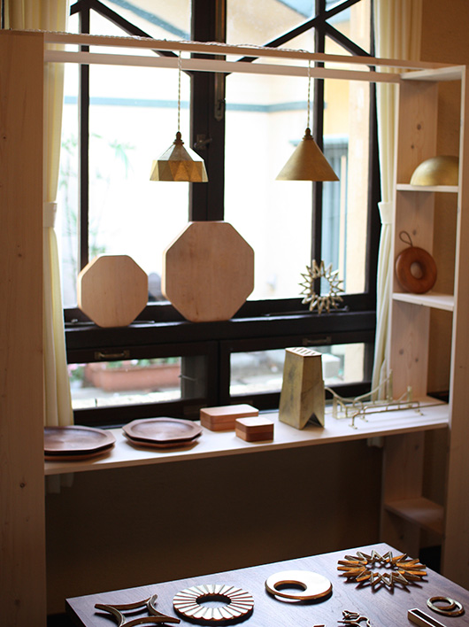FUTAGAMI pendant lamps, bottle openers, and KAMI wooden objects designed by Masanori Oji.