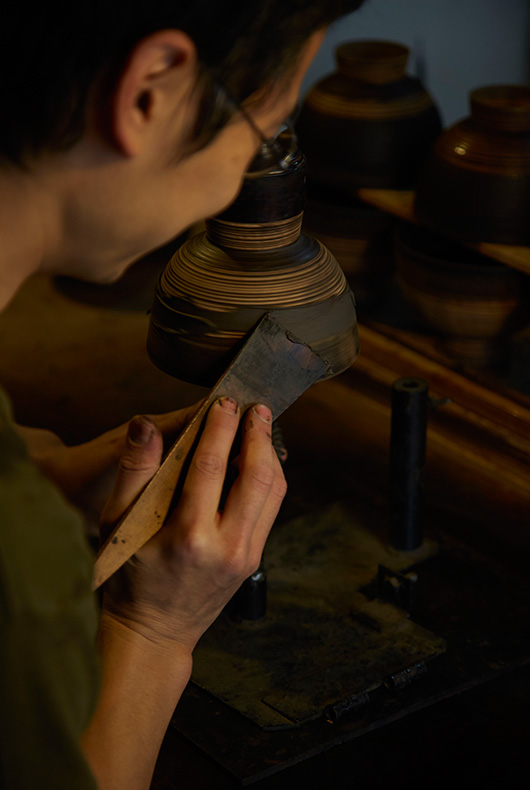 Applying the lacquer thickly and then smoothing it out.