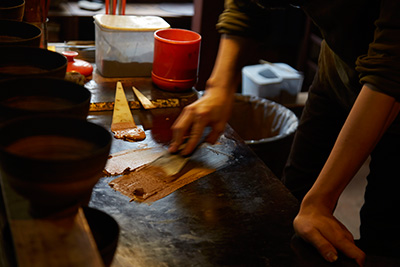 He mixes the lacquer to generate a new batch of urushi, this will be used to coat his works.