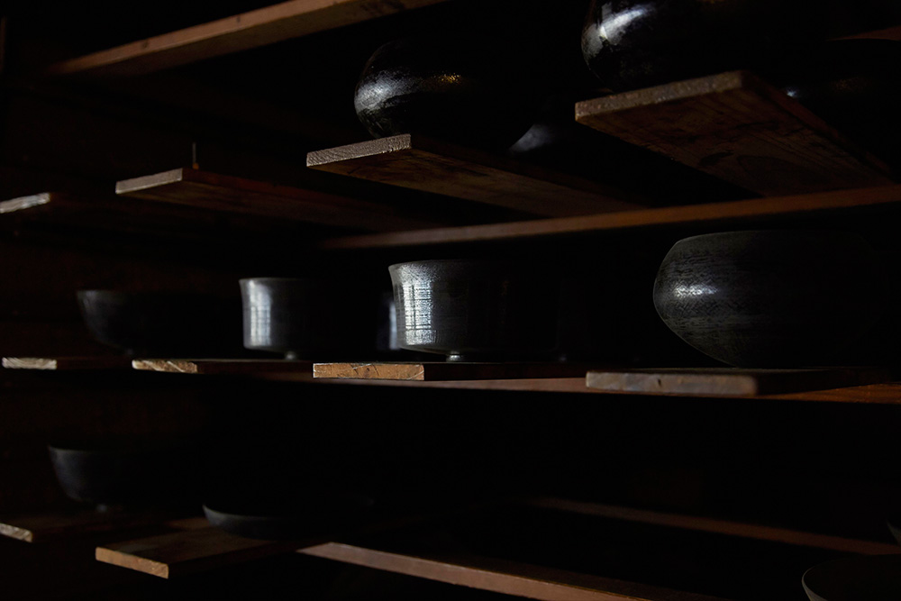A selection of black lacquer works sitting on the shelf in Akihiko's studio.