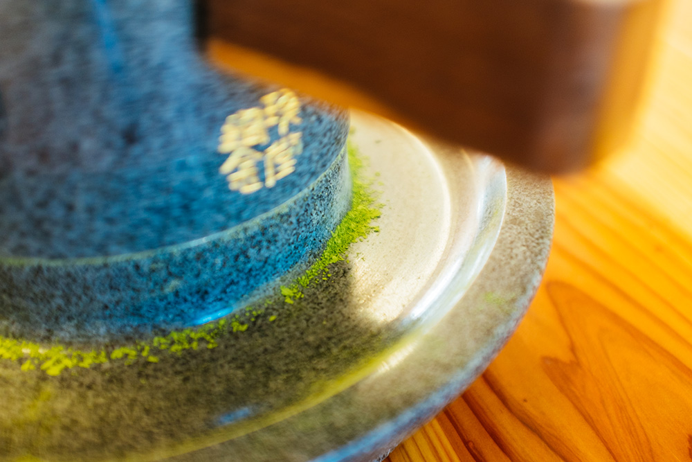 Matcha is made by grinding the tea leaves using a stone mill to create a fine green powder.