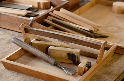 Japanese chisels and tools, also wood blanks that have yet to be worked on.